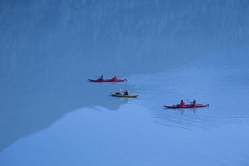 visitors enjoying kayak adventure Valdez Glacier Alaksa