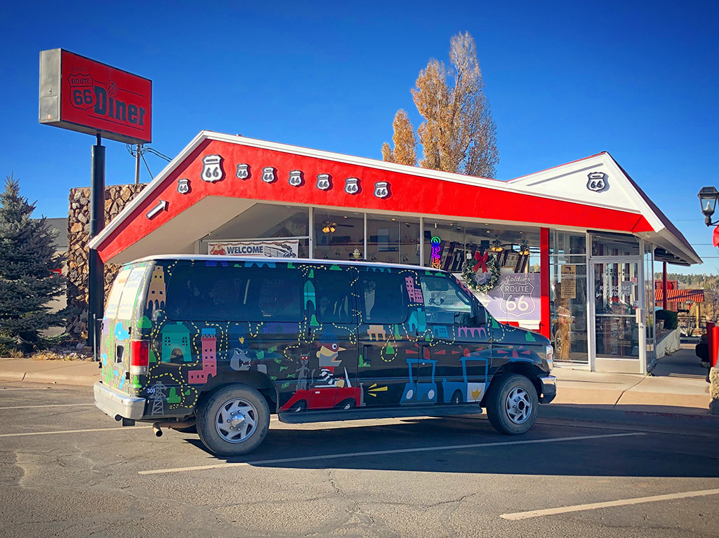 van in front of route 66 diner - how to choose vehicle for roadtrip